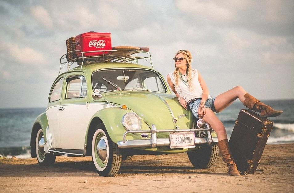 vintage car, woman, luggage, sand, clouds, sea, beach, coca-cola icebox