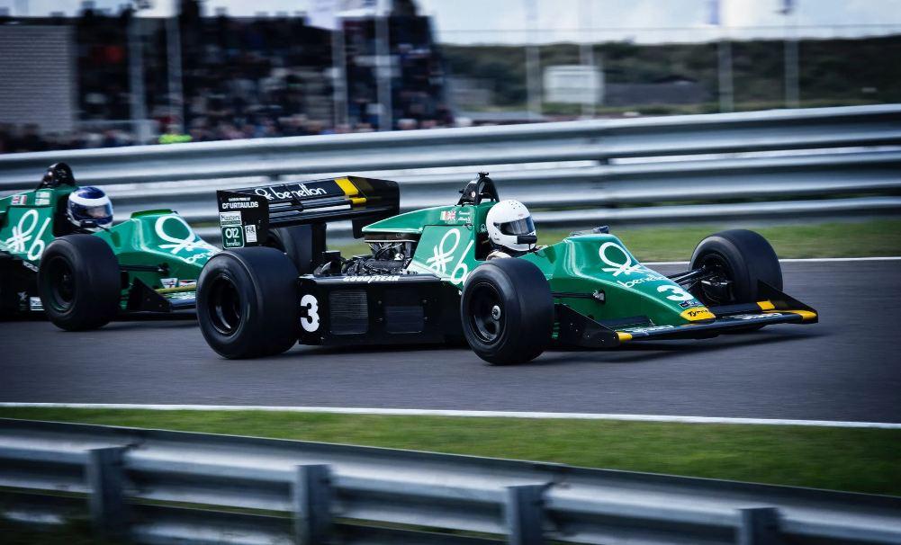 A man riding a racing car