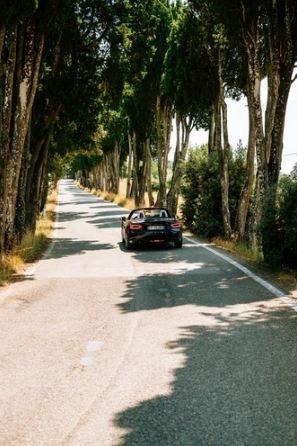 car going through beautiful scenery
